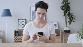 Man Using Smartphone, Browsing online Internet royalty free stock images