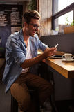 Man using a smartphone. In the cafe Royalty Free Stock Photography