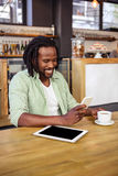 Man using a smartphone. In the cafe Royalty Free Stock Image