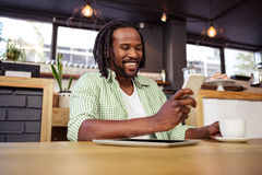 Man using a smartphone. In the cafe Stock Photo