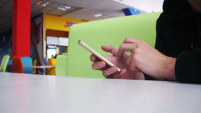 Man using a smartphone in cafe stock video footage