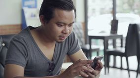 Man using smartphone. In cafe stock footage