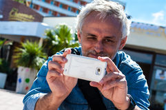 Man using smartphone camera Royalty Free Stock Photo