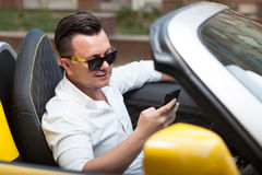 Man using smartphone in car Royalty Free Stock Images