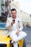 Man using smartphone in car Stock Photos