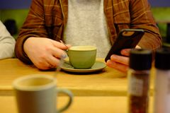 Man using smartphone close up in the cafe stock image