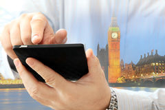 Man using smartphone. Close up of man using smartphone on London Big Ben background Stock Photo