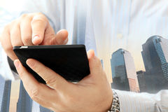 Man using smartphone. Close up of man using smartphone on urban background Stock Photography