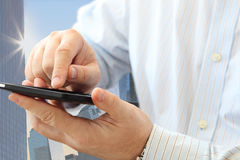 Man using smartphone. Close up of man using smartphone on urban background Royalty Free Stock Photography