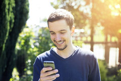 Man using smartphone. Royalty Free Stock Photos