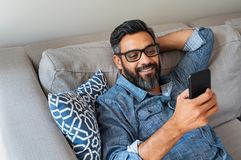 Man using smartphone at home royalty free stock photography
