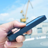 Man using a smartphone in an industrial park Stock Photos