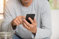 Man using smartphone Royalty Free Stock Photo