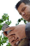 Man using smartphone. A man looking at cell phone in hand Stock Image