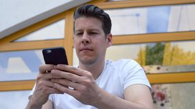 Man Using a Smartphone stock video footage