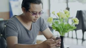 Man using smartphone. In cafe stock video