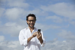 Man using smartphone Royalty Free Stock Photo