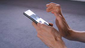 Man using smartphone in the room. Scrolling and touching. Technology concept stock footage