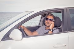 Man using smartphone while sitting in his car stock photos