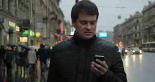 Man using smartphone on the street stock footage