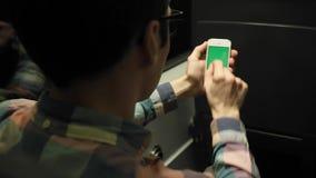 Man Using Smartphone in Train Green Screen Phone. Green Screen Smartphone , In Subway a Man on the Train, Using Phone for See Something In Subway stock video footage