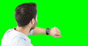 Man using smartwatch. Against green background 4k stock video