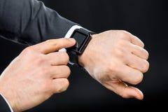 Man using smartwatch royalty free stock photos