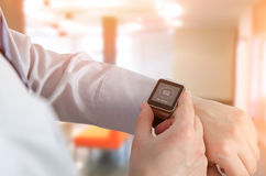 Man using smartwatch with e-mail notifier Stock Images