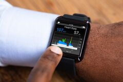 Free Man Using Smartwatch Showing Heart Rate Stock Photography - 214514172