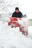 Man using a snowblower Royalty Free Stock Images