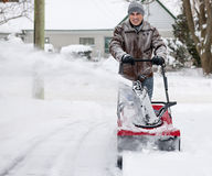 Man using snowblower in deep snow stock images