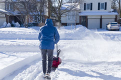 Man Using Snowblower to Clear Snow #3. Man removing snow with a snow blower #3 royalty free stock photos