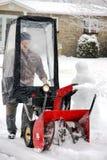 Man using snowblower royalty free stock photography