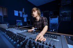 Man using a Sound Mixing Desk. In a recording studio Stock Photo