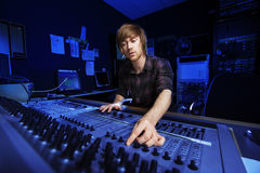 Man using a Sound Mixing Desk Stock Image