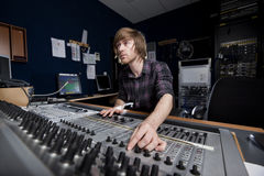 Man using a Sound Mixing Desk. In a recording studio Stock Image