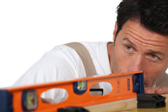 Man using a spirit level Royalty Free Stock Image
