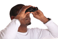 Man using spyglass Stock Photo