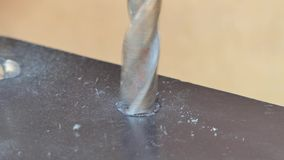 Man using a steel drill for drill metal. Metalworking, industrial background stock video