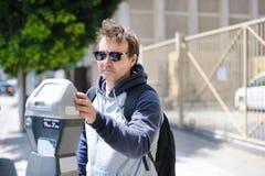 Man using street parking meter Royalty Free Stock Photo
