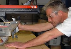 Man using table saw Stock Photo