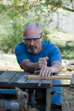 Man using table saw Royalty Free Stock Images