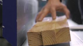 Man Using a Table Saw to cut wood, grinding on modern furniture factory. Man Using a Table Saw to cut a 2 by 4 of Wood (Sawdust Flying stock footage