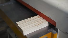 Man Using a Table Saw to cut wood, grinding on modern furniture factory stock video footage