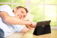 Man using tablet Stock Images