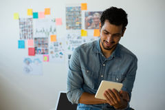Man using tablet against adhesive notes at office Royalty Free Stock Images