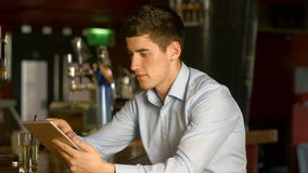 Man using tablet at the bar. High quality 4k format stock video