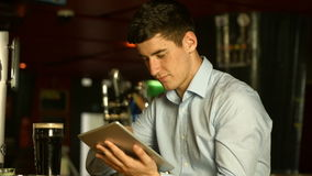 Man using tablet at the bar stock video