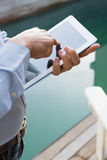 Man using tablet. Close up of man using tablet Royalty Free Stock Photo