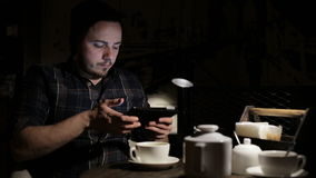 Man using tablet computer in cafe in the evening stock footage